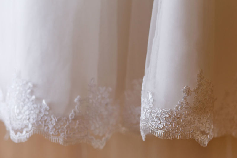 wedding dress close up. white wedding dress with lace White Color No People Indoors  Close-up Selective Focus Hanging Pattern Focus On Foreground Textile Lace - Textile Day Full Frame Vulnerability  Wedding Dress Softness Wedding Gown Design Tailor