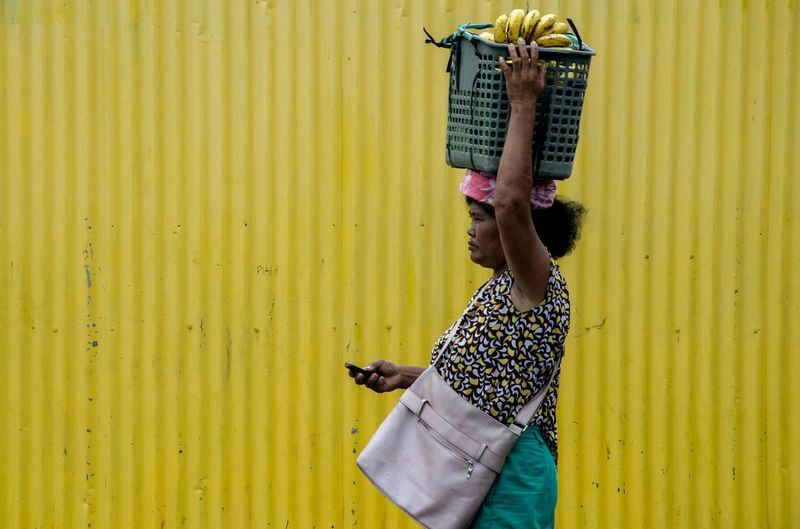 Streetphotography Eyeem Philippines People People And Places Yellow Banana Vendor Minimalist Minimalism Color Market Cebu Philippines Snap a Stranger Enjoy The New Normal What Who Where My Year My View Exploring Style Waiting Game