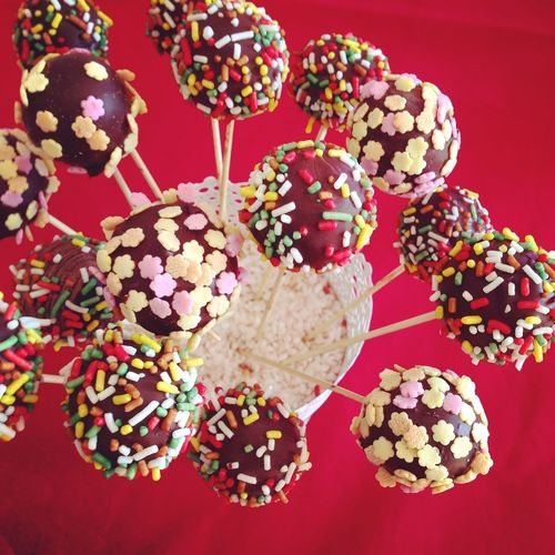 Colorful cakepops top view on red background Above Cakepop Cakepops Chocolate Choice Close-up Dessert Dessert Food Food And Drink Indoors  Many Pop Popcake Sprinkles Stick Sugar Sweet Sweet Food Table Top View Variation