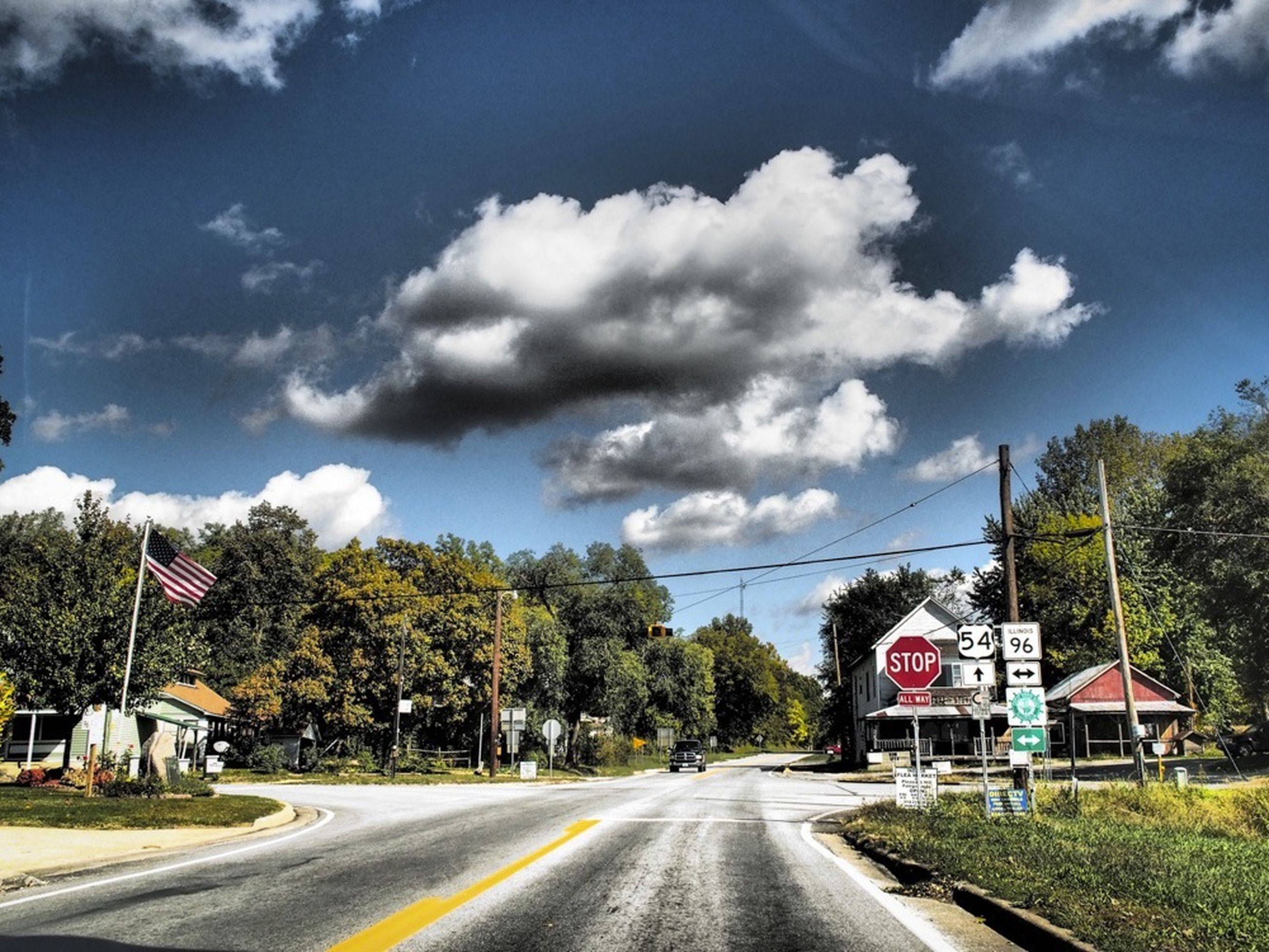 road, transportation, the way forward, sky, cloud - sky, tree, diminishing perspective, road marking, vanishing point, street, country road, cloud, cloudy, empty road, car, empty, blue, building exterior, day, road sign