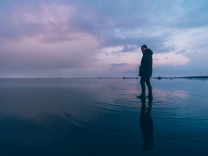 Icelandic self-portrait Iceland Stokksnes Waterfront Reflection Looking At View Horizon Over Water Tranquility Beauty In Nature Scenics - Nature Cloud - Sky Sea Sky One Person Water Standing Real People Horizon Tranquil Scene Leisure Activity Nature Sunset Outdoors