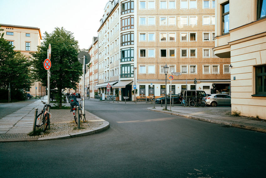 A warm evening in Berlin Mitte City City Street Daytime Street Life Architecture Berliner Ansichten Bicycle Building Building Exterior Built Structure Car City City View  Day Daylight Incidental People Real People Residential Building Residential District Residential Structure Road Street Streetphotography Transportation Tree