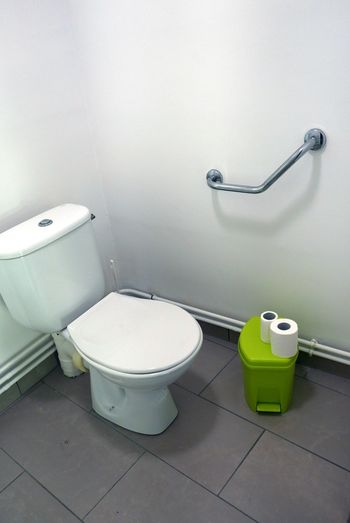 High angle view of toilet paper with toilet bowl in bathroom