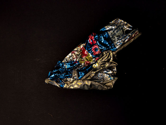 Can Crumpled Food And Drink Aluminium Can Black Background Close-up Consumerism Copy Space Expense High Angle View Indoors  Luxury Multi Colored No People Personal Accessory Shiny Single Object Still Life Studio Shot Wealth