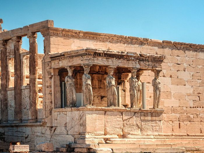Ancient Architectural Column Architecture Bad Condition Blue Building Exterior Built Structure Clear Sky Deterioration Erechtheion Exterior Historic History Low Angle View No People Obsolete Old Old Ruin Outdoors Ruined Run-down Sky Sunlight The Past Travel Destinations