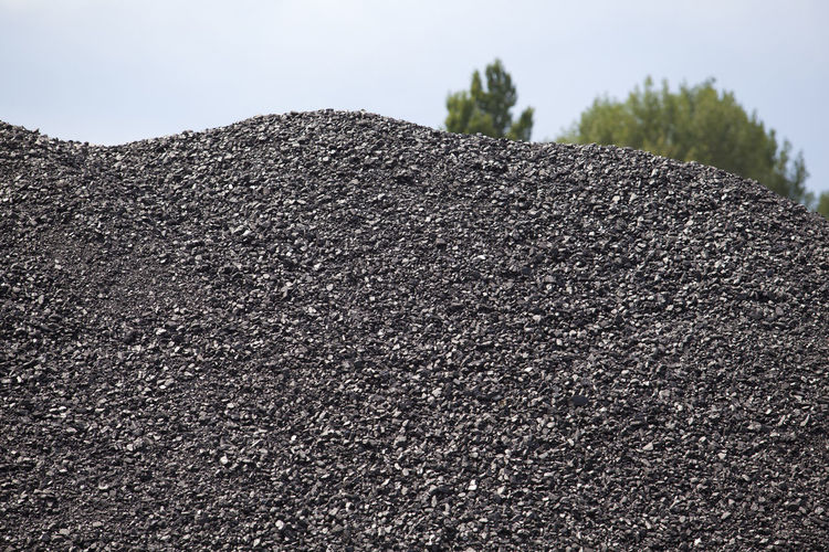 Black coal pile with the nature in the background Fuel Textured  Abundance Black Coal Carbon Charcoal Co2 Coal Coal Pile Energy Environmental Damage Environmental Issues Fossil Fuel Heap Heat Heating Industry Mining Mining Industry Outdoors Pile Pollution Stack Stockpile