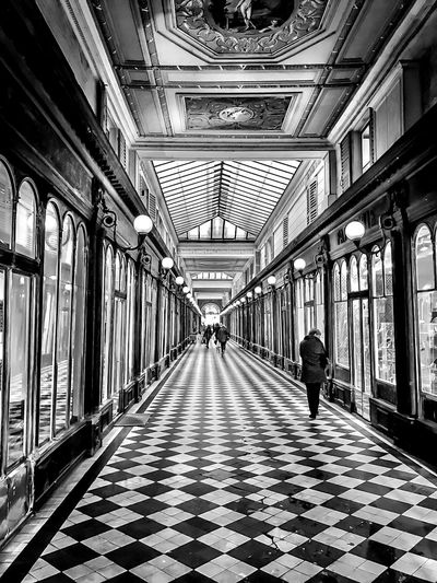 Paris arcade Shopping Mall Windows Glass Optical Illusion Perspective Light And Shadow Black And White Mosaic Tiles Arcade Paris, France  Indoors  Real People The Way Forward One Person Architecture Full Length Built Structure
