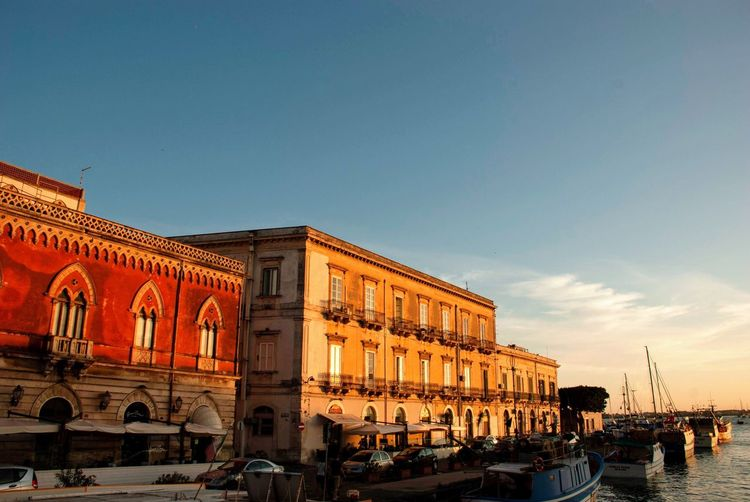 Coast Harbor Boats Sea Red Buildings Houses Architecture Palazzo Syracusa Sicilia Sicily Italian Italy Sky Building Exterior Architecture Built Structure Nature Water Building Nautical Vessel Sunset