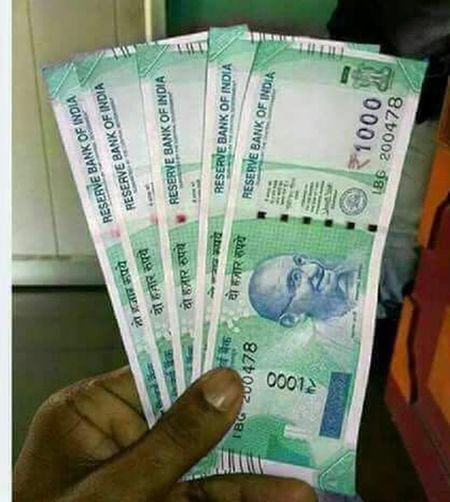 New 1000 notes Paper Currency Human Body Part Human Hand Currency Wealth Finance Close-up Only Men Men People One Man Only Adult Indoors  Adults Only One Person Day