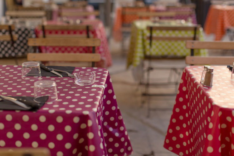 Shallow depth of field view of street cafe tables at Aix-en-Provence Cafe Close-up Decoration Dots Focus On Foreground Food And Drink Kitchen Utensils Leisure Activity No People Order Ornament Outdoors Red Selective Focus Street Table Cloth