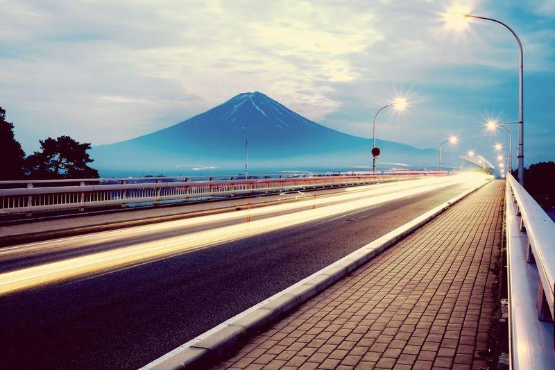 Illuminated Street Against Mount Fuji