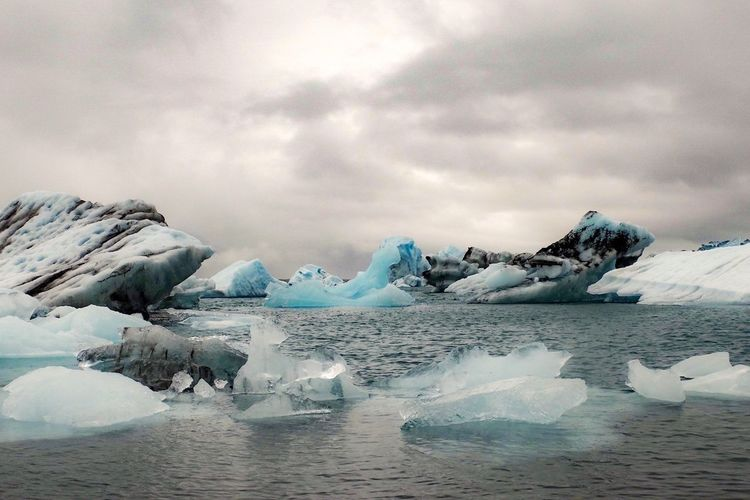 Jökulsárlón Iceland Cold Temperature No People Sky Tranquil Scene Scenics Tranquility Frozen Iceberg - Ice Formation Beauty In Nature Water Melting Ice Glacier White Reflection Floating On Water Cloud - Sky Lake Global Warming