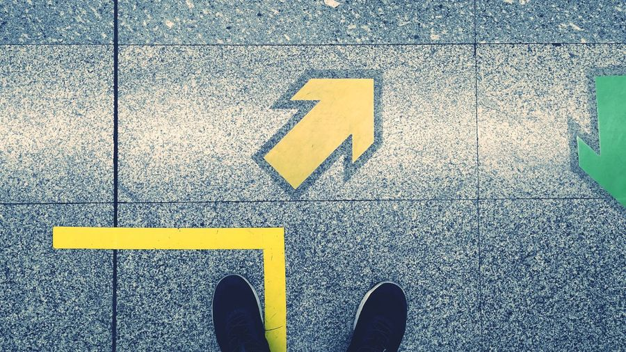 Low Section Yellow Human Leg Arrow Road Sign Guidance Direction Shoe Communication Arrow Symbol Arrow Sign Yellow Line Information One Way