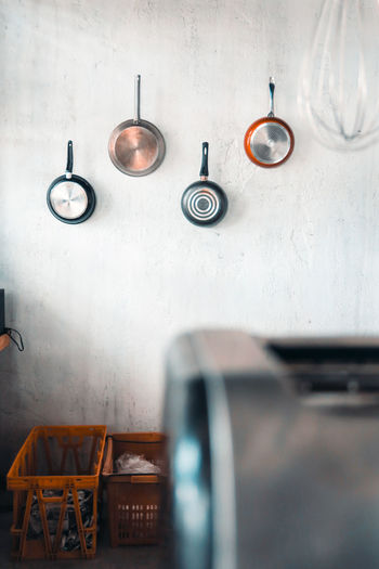 View of cooking pan hanging on wall