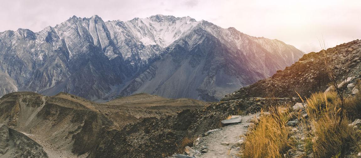 Scenic view of snowcapped karakoram mountain range against sky in passu. gilgit baltistan, pakistan