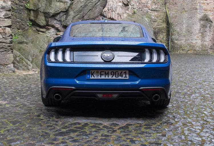 Ford Ford Mustang Mustang Blue Car Day Front View Land Vehicle Mode Of Transportation Motor Vehicle Nature No People Old Outdoors Retro Styled Solid Stationary Text Transportation Tree Wall Western Script