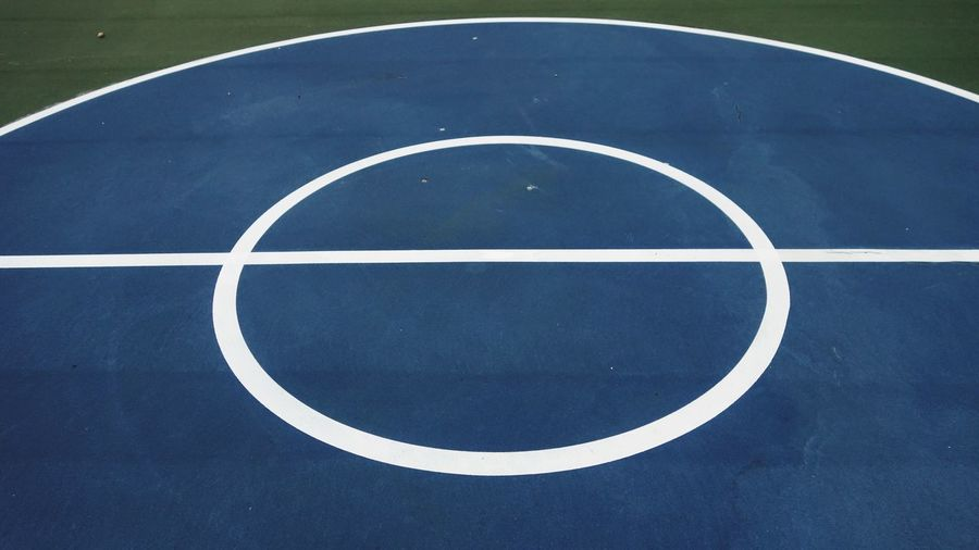 Blue Center Geometric Shape No People Sport Basketball - Sport Court Circle Day Shape High Angle View White Color Outdoors Blue Curve Pattern Design Yard Line - Sport Nature Sunlight Absence