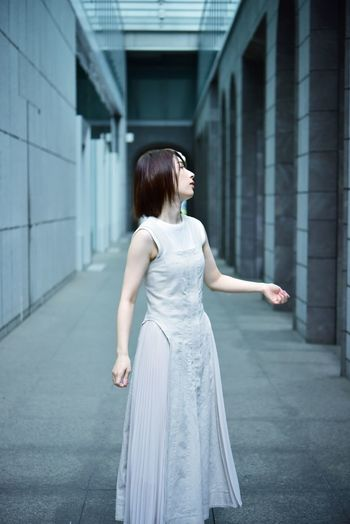 Full length of woman standing in city