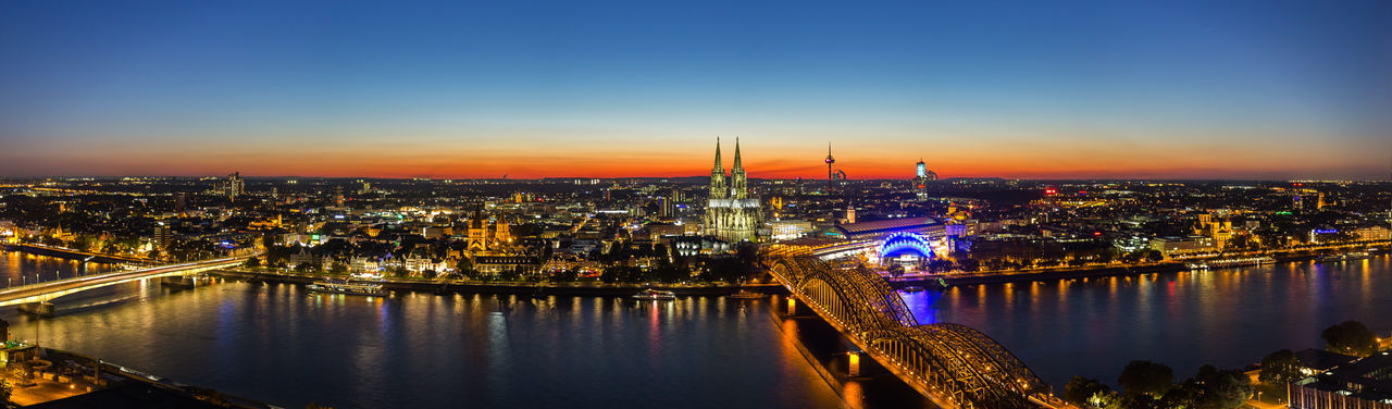 Cologne Sunset Skyline Panorma Cathedral Cologne Old Town Panoramic Skyline Architecture Bridge - Man Made Structure City Cityscape Germany Hohenzollernbrücke Illuminated Illuminated Building Night North Rhine Westfalia Outdoors Panroma Rhine River River Sky Skyscraper Sunrise Sunset Travel Destinations Urban Skyline