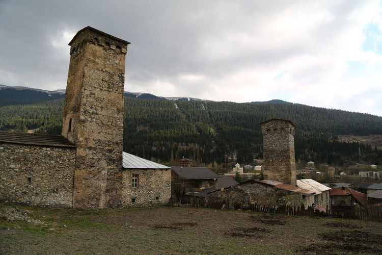 Architecture Built Structure Sky Building Exterior Cloud - Sky History The Past Building Nature Old Mountain Ancient No People Day Plant Old Ruin Land Outdoors Field Travel Destinations Ancient Civilization Archaeology Georgia Mestia/town In Svaneti/Georgia