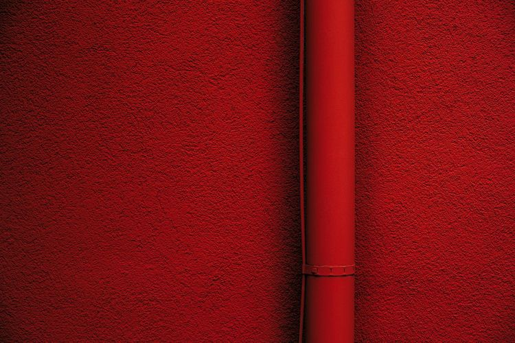 Urban Perspectives Minimalism Red Backgrounds No People Close-up Full Frame Built Structure Architecture Indoors  Textured  Wall - Building Feature Pattern Day Red Background Wall Pipe - Tube Vibrant Color The Devil's In The Detail Street Photography Architectural Detail The Minimalist - 2019 EyeEm Awards My Best Photo