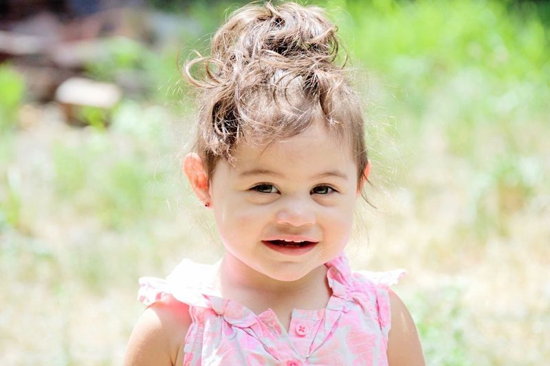 Innocence Portrait Cute Looking At Camera Childhood One Person Happiness Outdoors Curly Hair Smiling Day Babies Only Bright Summer Children Children Only One Girl Only Child Twoyearold  Detroit Innocence Enjoying Life Cutie Looking At Camera