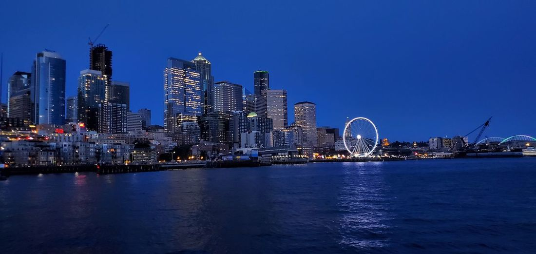 Seattle ferris wheel from the water at night