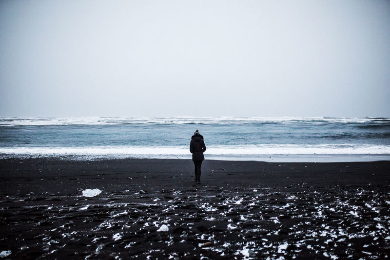 Iceland Beach Beauty In Nature Black Sand Black Sand Beach Clear Sky Day Full Length Horizon Over Water Iceland_collection Nature One Person Outdoors People Real People Rear View Scenics Sea Sky Standing Tranquil Scene Tranquility Vacations Water Wave