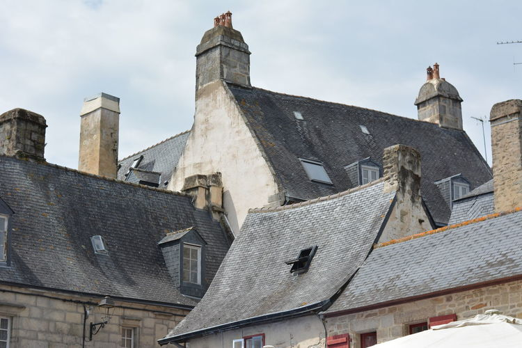 chimneys and roof - to keep us warm and to protect us from the weather. Architectural Detail Building Exterior Built Structure Chimneys City Exterior Greyscale No People Open Window Rooftops Slate Tiles Stone Houses