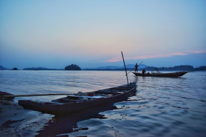 after the storm Landscape_Collection Landscape_photography Blue Hour River View Boat Canoe Water Sea Sky Fishing Occupation One Person Scenics - Nature Nautical Vessel Nature Fisherman Land Fishing Industry Activity Transportation Beauty In Nature