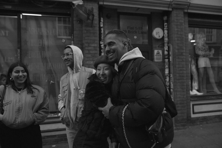 london London United Kingdom Street Group Of People Togetherness Young Adult Smiling Men Women Architecture Happiness Real People Young Women Emotion Adult Lifestyles Males  Clothing Portrait People Leisure Activity Warm Clothing Winter Positive Emotion Couple - Relationship British Culture