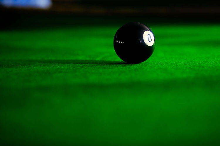 Close-up of ball on pool table