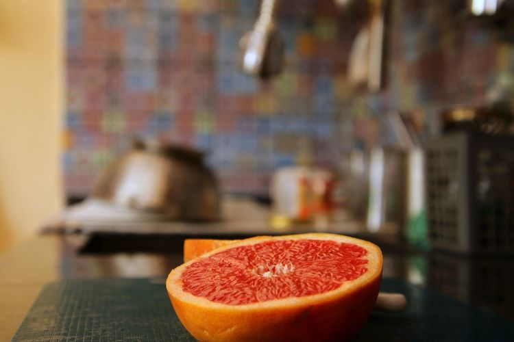 Close-up of grapefruit on table at home