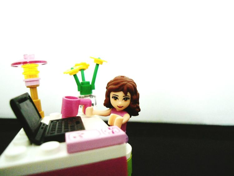 Working girl in office armed with coffee working on her laptop and reaching for her cellphone Working Working Hard Working Girl Coffee Office Laptop Cellphone Workaholic Working Girl In Office Working 9 To 5 LEGO Lego Office Lego Girl Typing Drinking Calling Girl Power