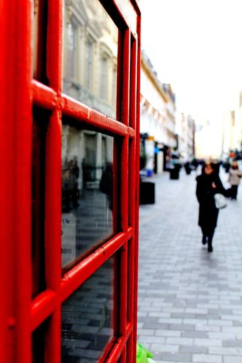 London Lifestyle Red Focus On Foreground City Public Transportation Building Exterior Telephone Booth Outdoors Day Architecture One Person People