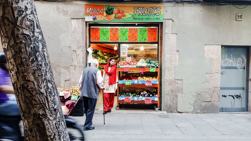 Retail  Full Length Store Outdoors Two People Consumerism Standing Market Adult Customer  People Building Exterior Architecture Lifestyles Built Structure Women Real People Barcelona People Watching EyeEm Vision Contrasts Contrast Fruits Portrait Grocery Shopping