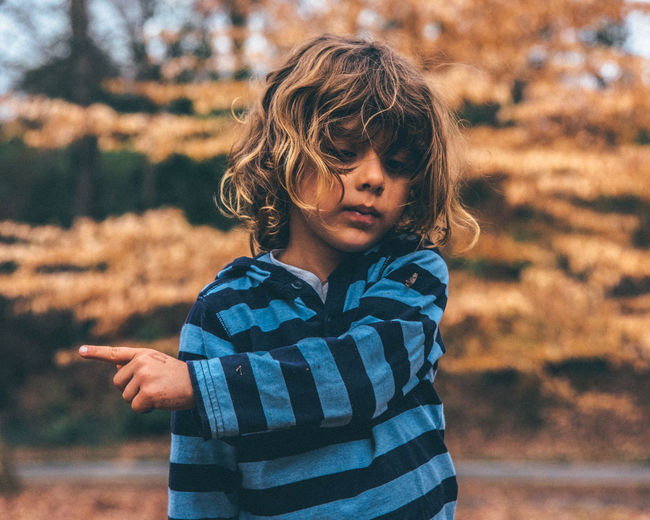 Directions Autumn Bokeh Photography Boy Child Childhood Children Children Only Children Photography Children's Portraits Day Human Body Part Human Hand Long Hair Nature One Person Outdoors Park - Man Made Space People Pointing Fingers Pointing The Way Portrait Trees