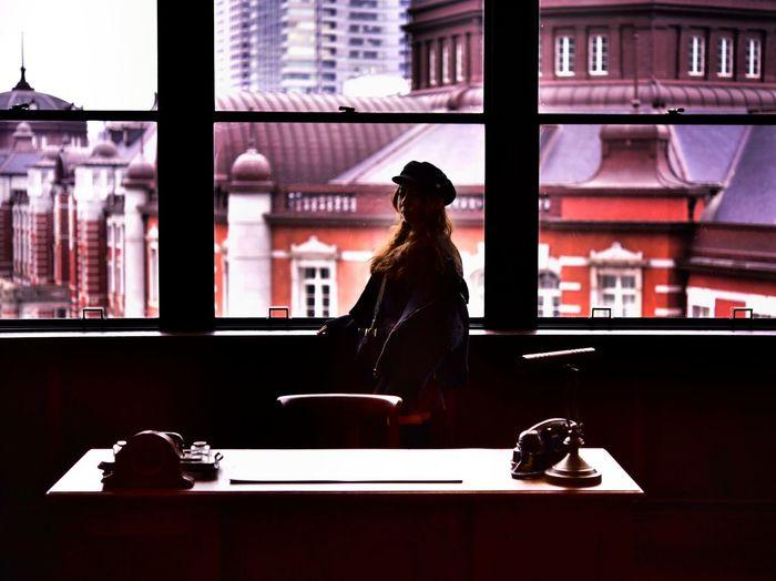 Woman standing by window in restaurant