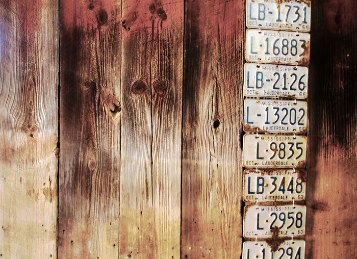 Old Mississippi License Plates on Barnwood Wall. Barnwood Close-up Communication Damaged Detail Focus On Foreground Geometry Information License Plates Metal Mississippi  Old Plank Rusty Safety Selective Focus Symbol Textured  Wall Wall Hanging Weathered Wood Wood - Material Wood Grain Wooden