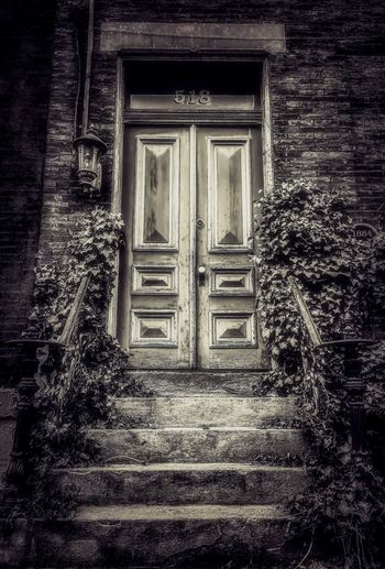Ivy Old Buildings Stone Taking Photos Walking Around Black And White Blackandwhite Bnw_friday_eyeemchallenge Bnw_doors_n_gates Architecture Built Structure Building Exterior Building Entrance Door Closed Residential District No People
