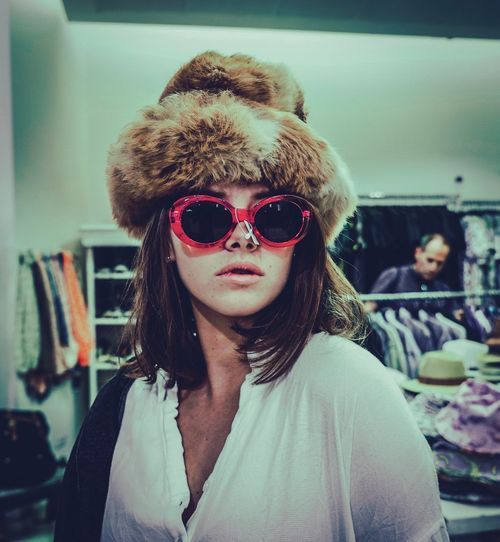 Portrait Of Woman Wearing Sunglasses And Fur Hat At Store