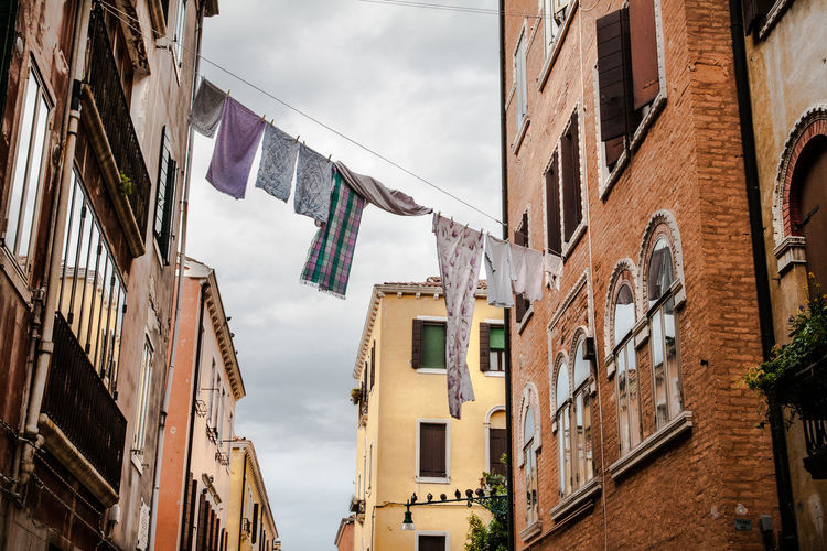 Apartment Architecture Balcony Building Exterior City Life Day Famous Place Hanging Clothes Low Angle View No People Outdoors Residential Building Residential Structure Sky Tourism Travel Destinations Venice