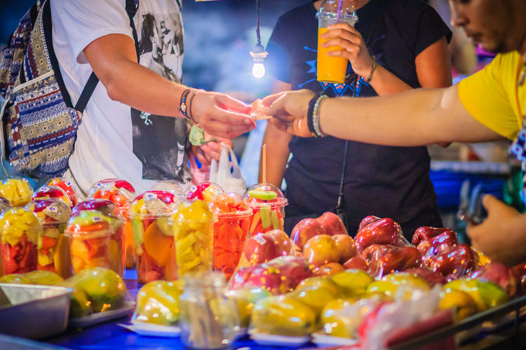 Close up street fruit vendor selling mixed fruits at Khao San Road night market, Bangkok, Thailand. Khao San Rd Khao San Road KhaoSan Khaosan Rd. Khaosandroad Street Food Festival Street Food Vendors Fruit Seller Khao San Khao San Knok Wua Khao San Rd. Khaosan Road Khaosanroad Mixed Fruits Street Food Street Food In Thailand Street Food Market Street Food Of Thailand Street Food Stall Street Food Thailand Street Foods Street Foods Photography