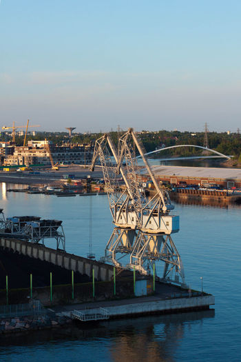Blue Built Structure Container Crane Crane Engineering Evening Light Harbor Nature No People Outdoors Port Sky Water