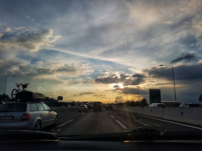 Rainy Road Trip Travel Landscape Highway Sunset City Road Land Vehicle Water Car Dramatic Sky Sky Cloud - Sky Car Point Of View