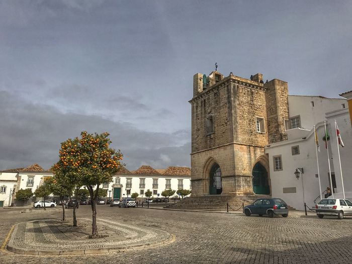 Faro Cathedral Faro Cathedral Architecture Built Structure Building Exterior Sky Outdoors Religion Tree Travel Destinations Cloud - Sky Place Of Worship No People Day