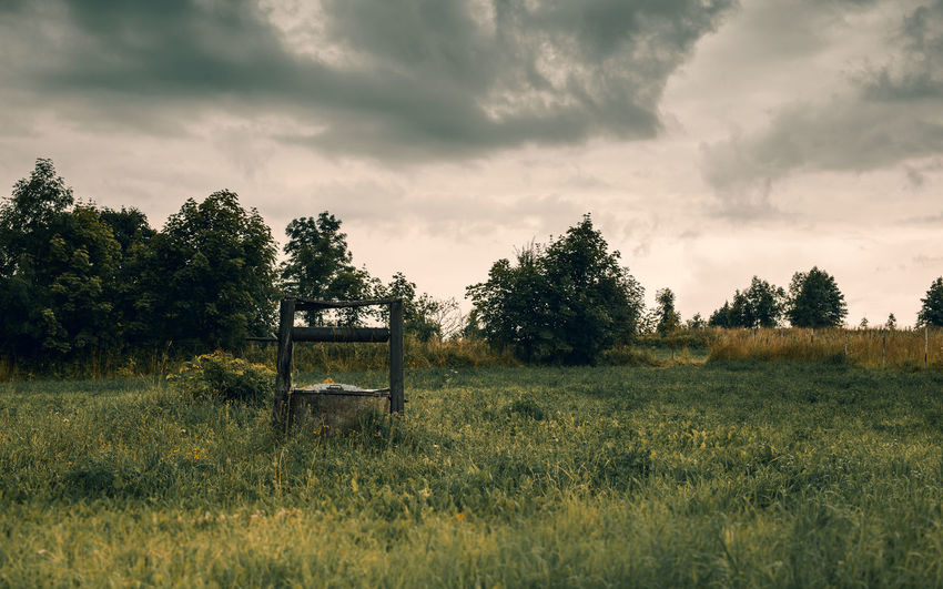 Abandoned Beauty In Nature Cloud - Sky Day Field Grass Green Color Growth Landscape Nature No People Outdoors Scenics Sky Tranquil Scene Tranquility Tree