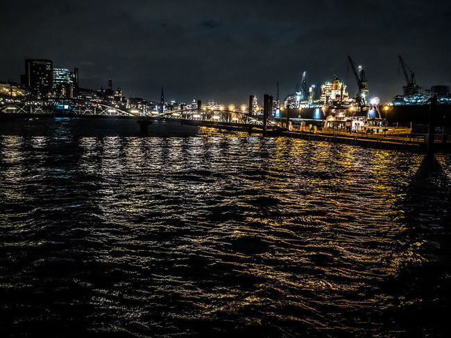 A Night at Hamburg's Riverside Elbe River Lights Reflection Riverside Water Reflections Architecture Built Structure City Lights Docklands Elbe Harbor Harborfront Illuminated Nautical Vessel Night No People Outdoors Port Rippled Water River Sea Sky Water Waterfront Waves