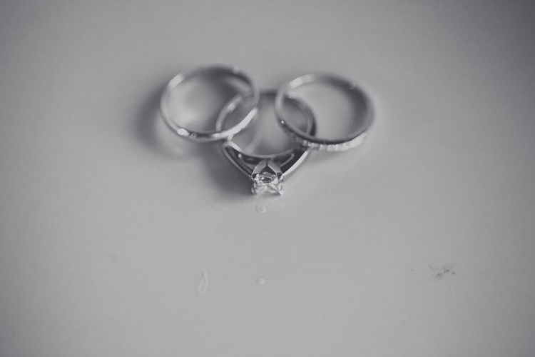 High angle view of wedding rings on heart shape