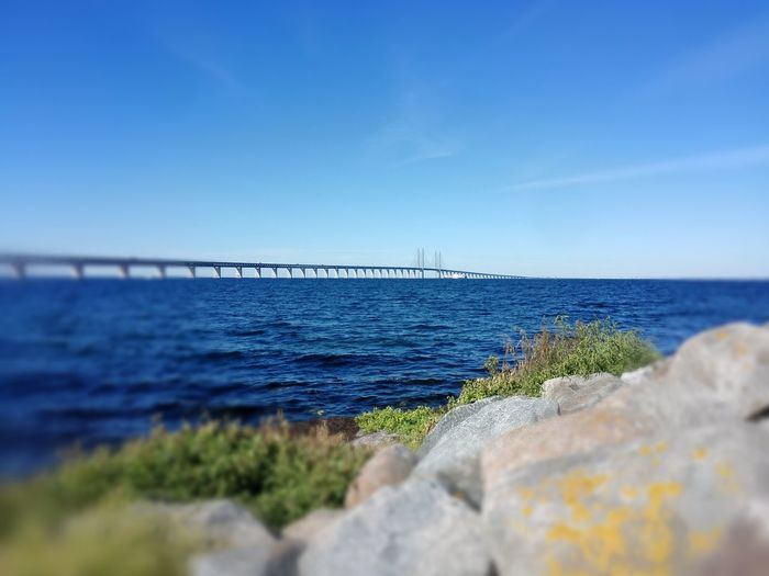 Sea Blue Horizon Over Water Water Sky Nature Day No People Outdoors Beauty In Nature Beach Refraction Bridge
